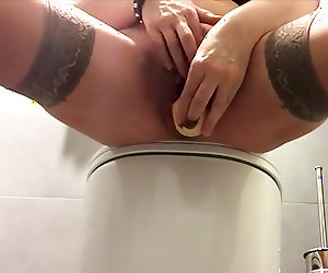 Busty brunette toying pussy and ass in the office bathroom
