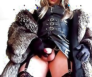 Transvestite Mistress in fur cumming