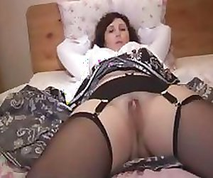 Busty mature babe slowly strips down to stockings and garter strap