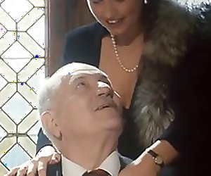 Suited Grandpa gets a blowjob