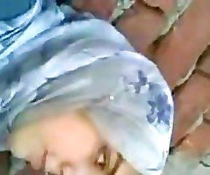 Arab girl kissing boyfriend brunettes c