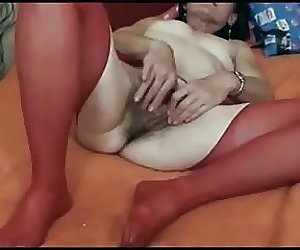Hairy old woman playing with hairy pussy (short clip)