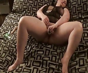 May playing with her dildo