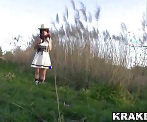 Brunette teen in an exclusive outdoor scene from Krakenhot