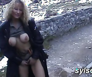 Sex toy in mountain before lesbian strap-on
